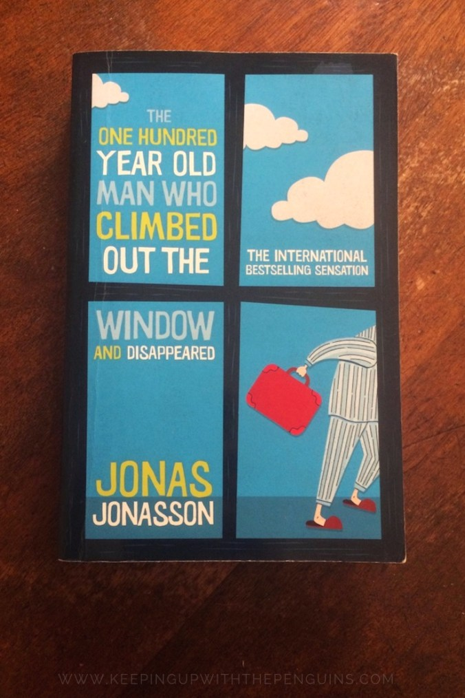 The One Hundred Year Old Man Who Climbed Out The Window And Disappeared - Jonas Jonasson - Book Laid on Wooden Table - Keeping Up With The Penguins