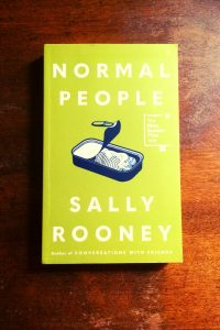 Normal People - Sally Rooney - Book Laid on Wooden Table - Keeping Up With The Penguins