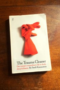 The Trauma Cleaner - Sarah Krasnostein - Book Laid on Wooden Table - Keeping Up With The Penguins
