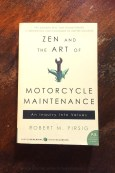 Zen and the Art of Motorcycle Maintenance - Robert M Pirsig - Book Laid on Wooden Table - Keeping Up With The Penguins