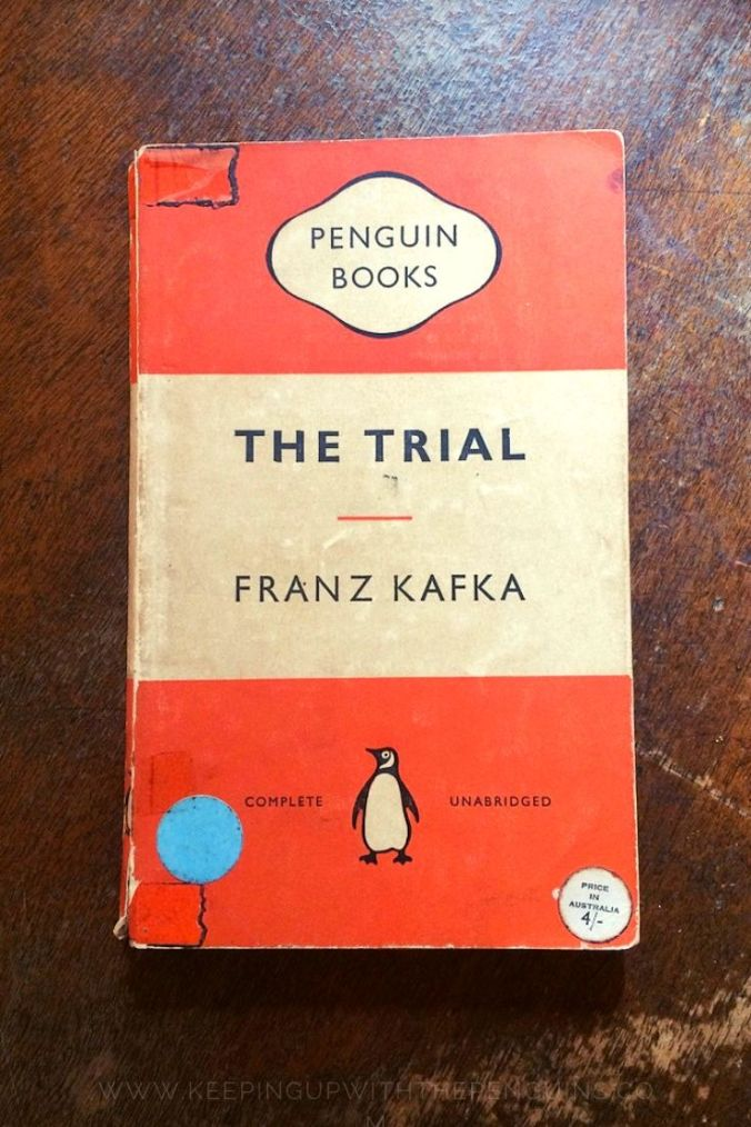 The Trial - Franz Kafka - Book Laid on Wooden Table - Keeping Up With The Penguins