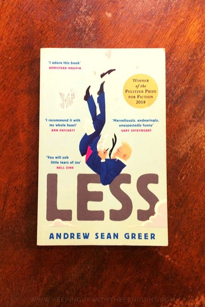 Less - Andrew Sean Greer - Book Laid on Wooden Table - Keeping Up With The Penguins