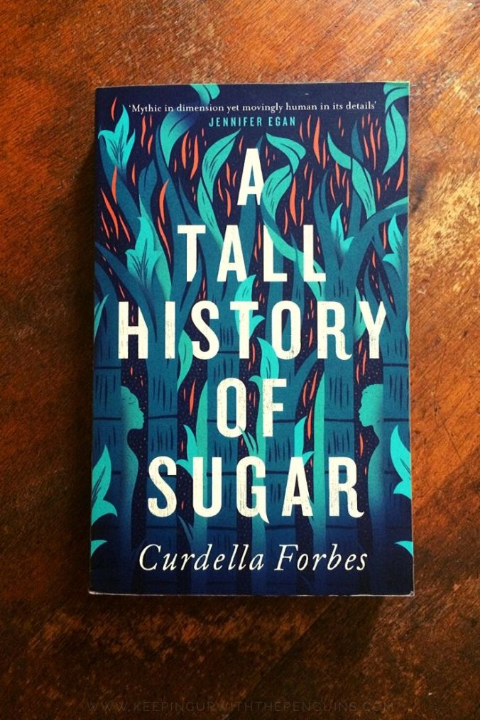 A Tall History Of Sugar - Curdella Forbes - Book Laid on Wooden Table - Keeping Up With The Penguins