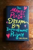 The Manic Pixie Dream Boy Improvement Project - Book Laid on Wooden Table - Keeping Up With The Penguins