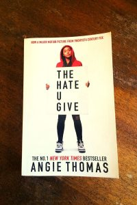 The Hate U Give - Angie Thomas - Book Laid on Wooden Table - Keeping Up With The Penguins