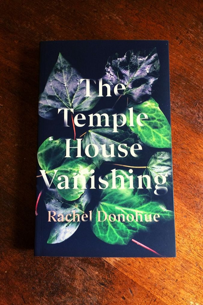 The Temple House Vanishing - Rachel Donohue - Book Laid on Wooden Table - Keeping Up With The Penguins