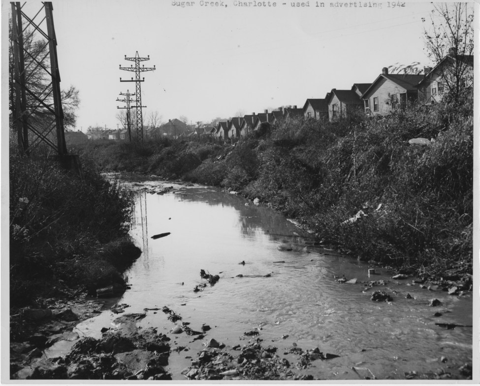 1942 image of houses near Little Sugar Creek. Photo courtesy Photo courtesy of Beaumert Whitton Papers, UNC Charlotte Atkins Library