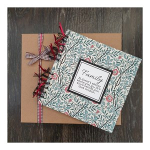 Scrapbook with gift box with with family text and william morris background design