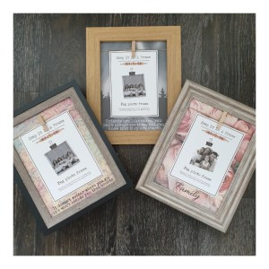 Three different peg photo frames with heart-warming quotes and family wording