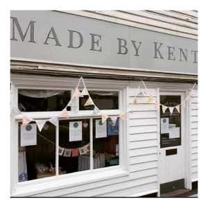 Shop front with white boarding and bunting, called Made by Kent