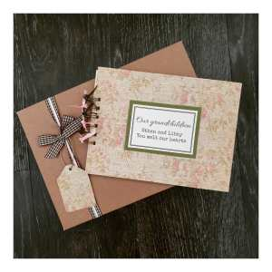 green and pink floral scrapbook with gift box and personalised grandchildren text
