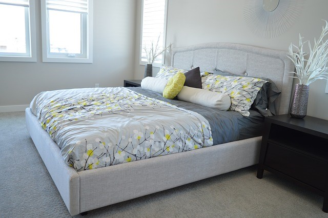 doubled bed in tiny bedroom