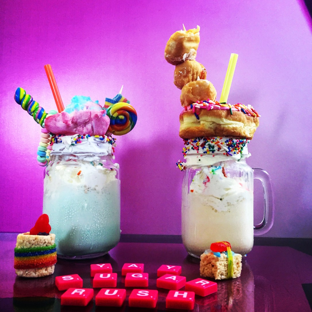 Sweet milkshakes topped with donuts and candy from SXSW at the Spredfast Social Suite