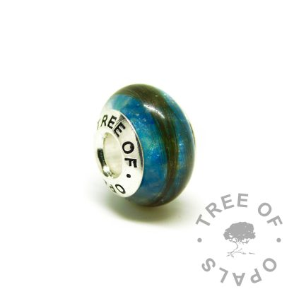 hair jewellery blue charm, strawberry blonde hair with Aegean blue resin sparkle mix. Tree of Opals branded core charm bead fits on Pandora bracelets