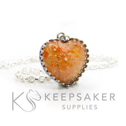 Orange ashes antique heart necklace. Crown point antique effect heart setting in solid sterling silver, 925 stamped. Tangerine orange resin sparkle mix. Shown with a medium classic chain (not included)