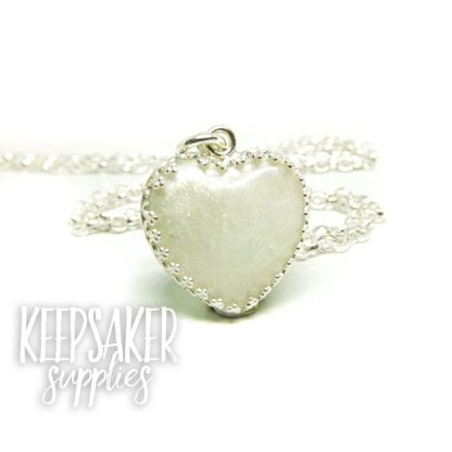 breastmilk heart necklace with unicorn white resin sparkle mix and breastmilk (mockup) in 18mm heart setting solid sterling silver