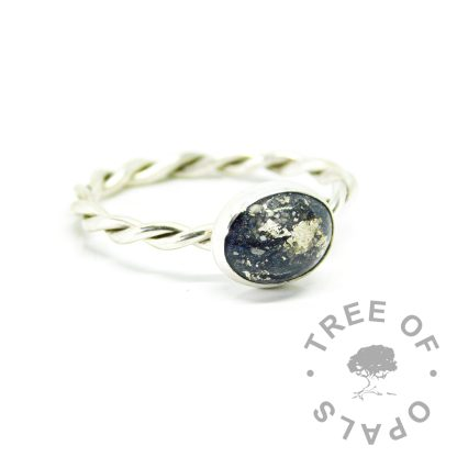 Ashes ring on twisted band with vampire black resin sparkle mix with white gold leaf. 10x8mm bezel cup and cabochon