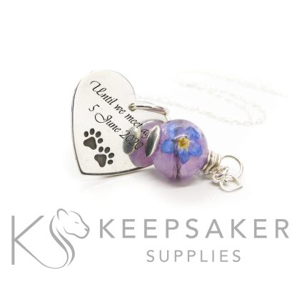 purple hair orb with a forget me not, lock of hair with orchid purple resin sparkle mix. Wire wrapped by hand with a solid silver setting. Shown with a a medium heart pendant with amazone BT font engraving with paw print emoji