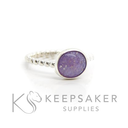 cremation ashes ring with purple sparkle mix on bubble band