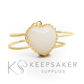 gold vermeil breastmilk heart, classic breastmilk with no sparkles. Shown with jump ring and necklace chain