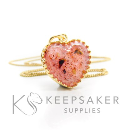 Gold vermeil umbilical cord heart necklace, fairy pink resin sparkle mix. Shown with jump ring and necklace chain
