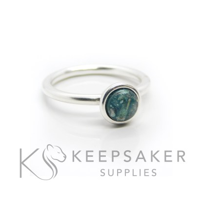 Teal ashes Ayla Solitaire Ring, cremation ashes and resin, with mermaid teal resin sparkle mix made into a cabochon (stone) and set into the ring with glue. Cast Argentium 935 anti-tarnish silver (higher purity than sterling)