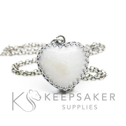 pearly blue breastmilk heart necklace, 18mm crown point antique effect sterling silver heart setting with breastmilk and resin heart. Subtle pearly blue breastmilk resin sparkle mix. Shown with chain upgrade