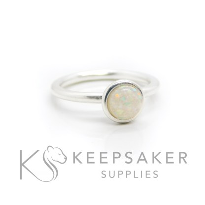 Opal beastmilk Ayla Solitaire Ring, preserved dried breastmilk in resin with synthetic opal pieces made into a cabochon (stone) and set into the ring with glue. Opal represents the five year breastfeeding award and also the October birthstone. Cast Argentium 935 anti-tarnish silver (higher purity than sterling)
