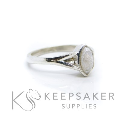Breastmilk Hannah Marquise ring with unicorn white resin sparkle mix, solid 935 purity Argentium silver, cast by hand in Scotland. Split shank band, engravable on the inside. 8x4mm marquise setting for filling or fitting a cabochon