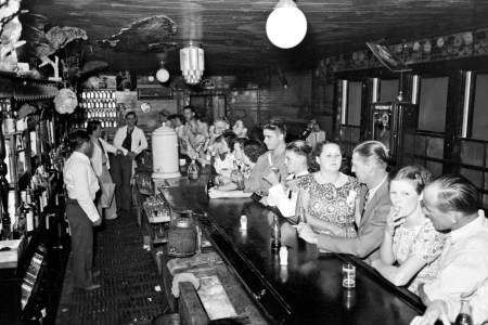 Russell Lee - Drinking at the bar, crab boil night, Raceland, Louisiana, 1938