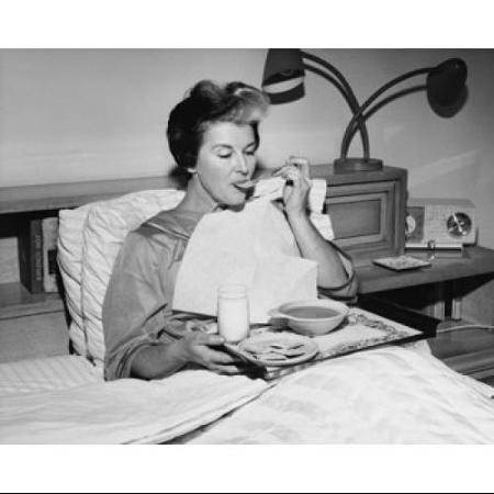 mature-woman-reclining-in-the-bed-and-eating-soup-poster-print-18-x-24_1899831