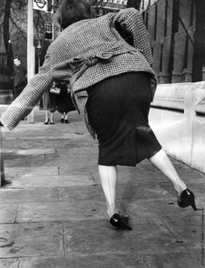 woman falling off heels
