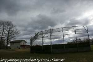 ballpark and trees and cloudy sky