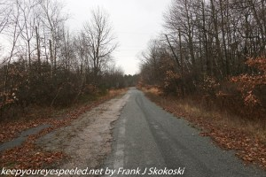 old macadam road on trail