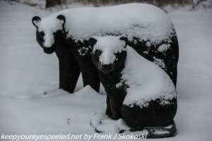 snow covered bear statues