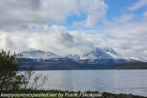 clouds and mountians on shore in Tromso