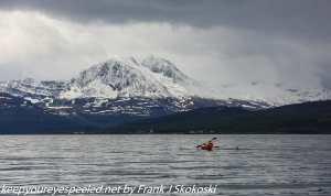 kayak and mountains on beach