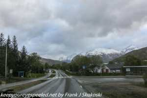 clouds and mountains on road near Tromso