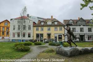 statues and houses Tromso