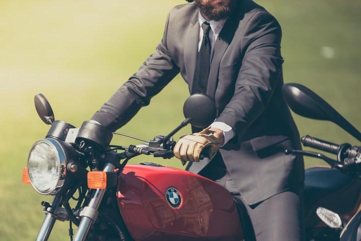 a businessman riding a bike