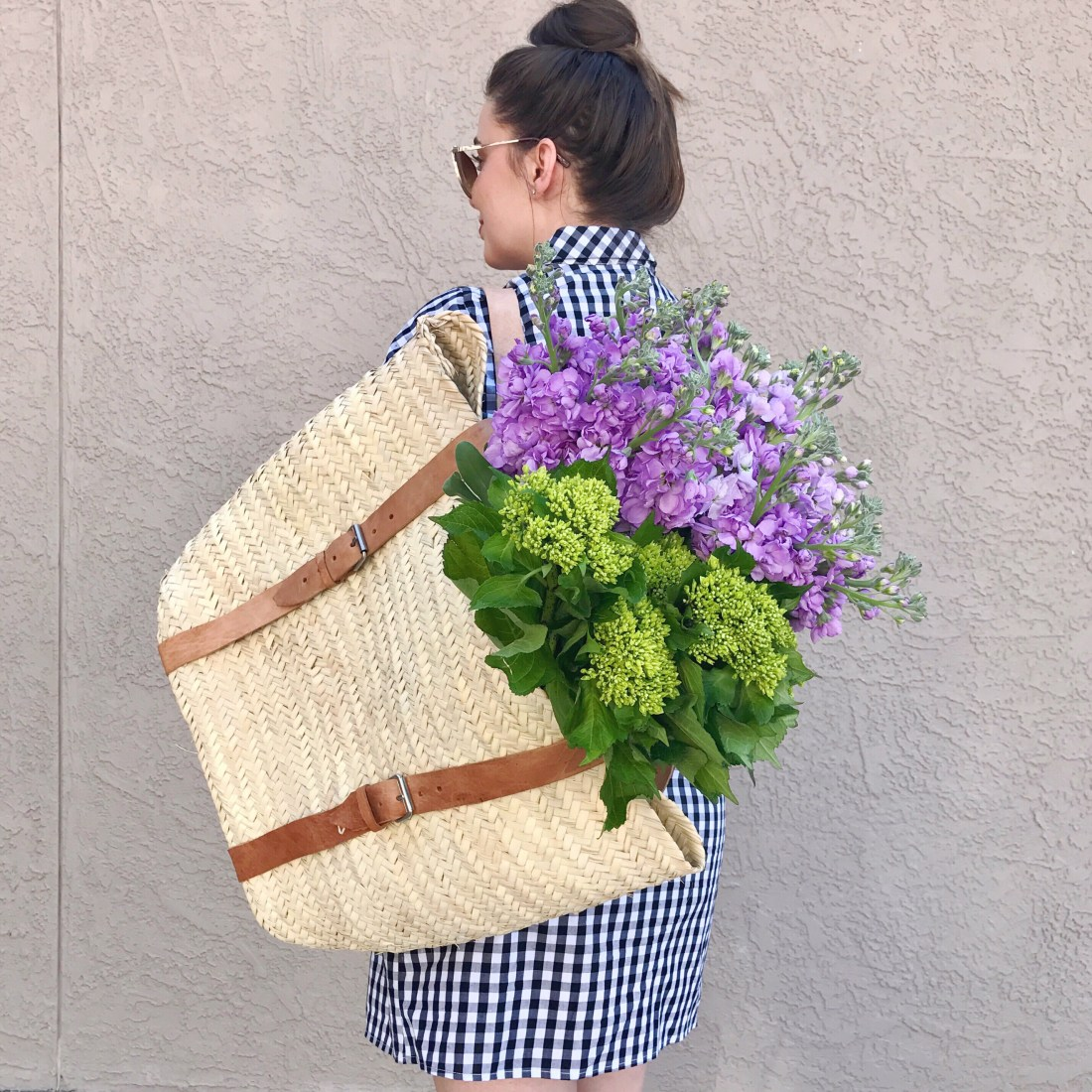 Hydrangea and stock flower in large basket bag backpack