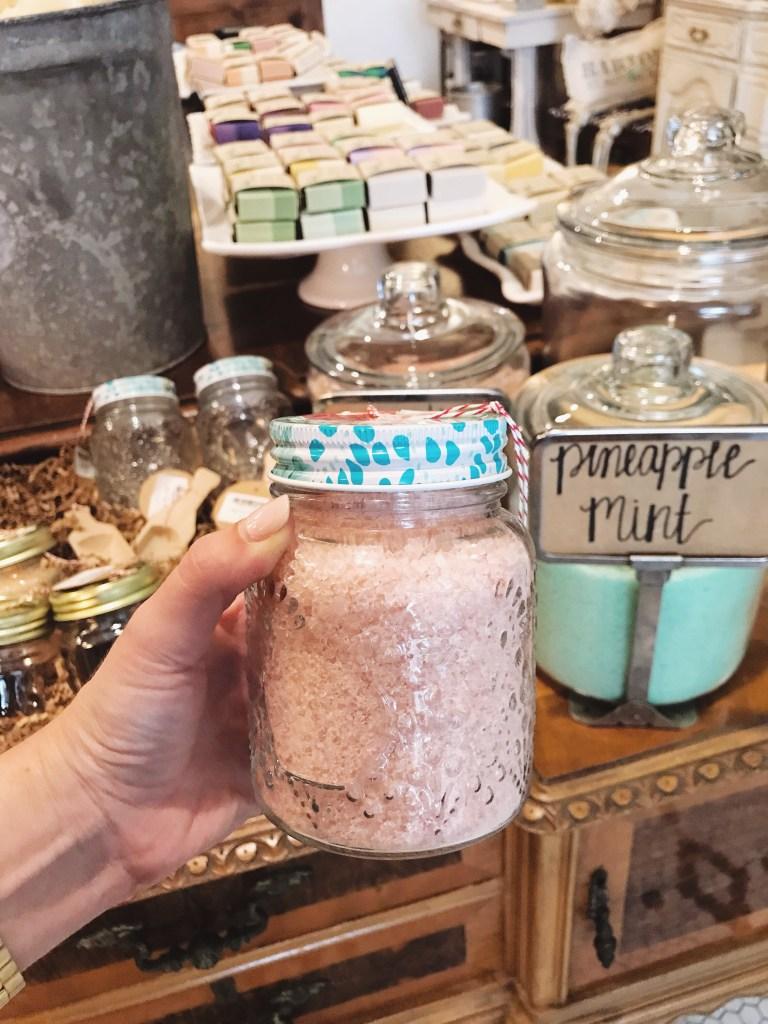 Rafa Natural handmade bath salts displayed in large glass apothecary jars.