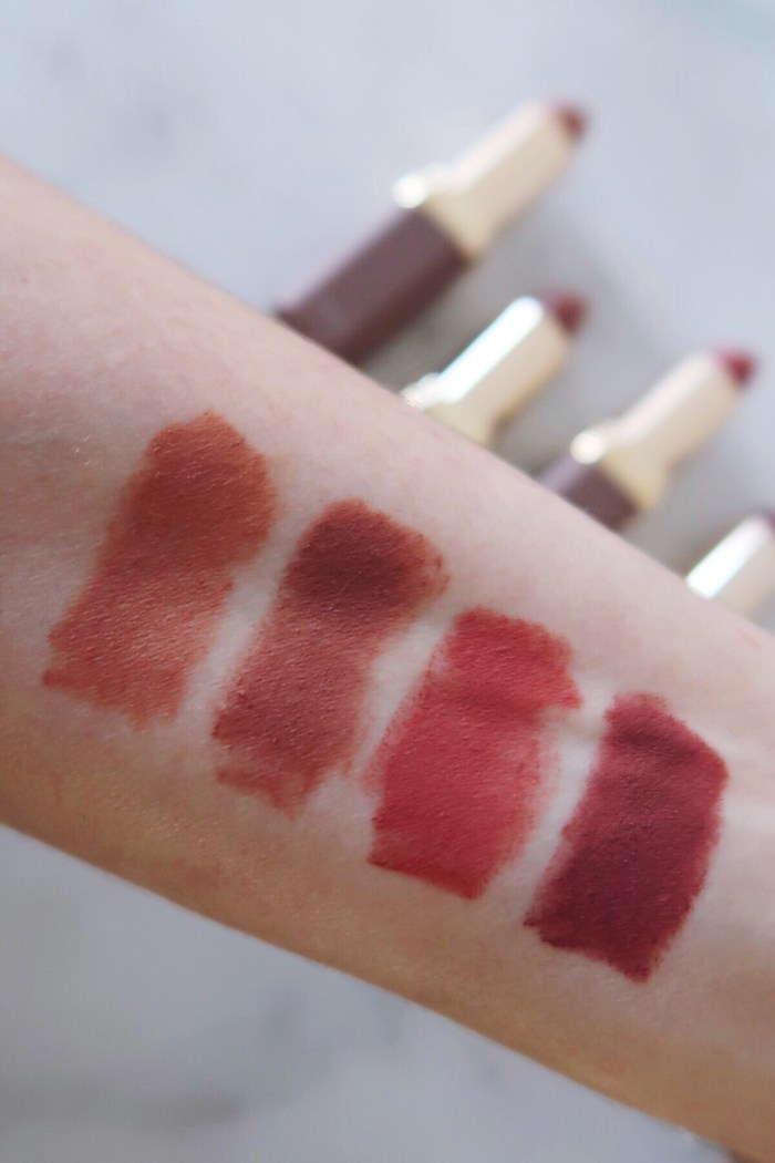 L'Oreal Colour Riche Ultra Matte Lipstick swatches on skin in natural daylight. From left to right: 983 Utmost Taupe, 978 All Out Pout, 977 Passionate Pink, 980 Rebel Rouge
