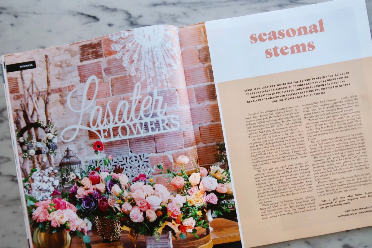Magazine spread in WH Magazine featuring Lasater Flowers, with a photo of various floral designs in front of a brick wall.
