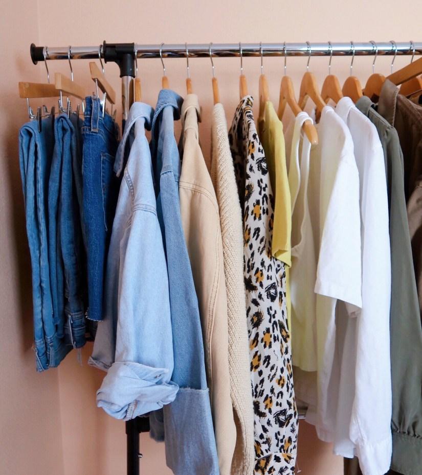 summer capsule wardrobe hanging on a clothing rack