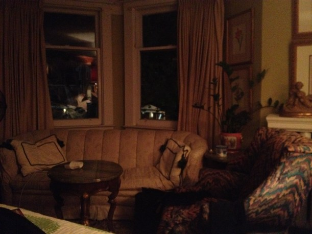 My room, looking away from the gilded chair, at the bay window couch I do my reading in.