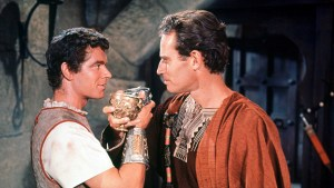 Messala (Stephen Boyd) and Ben-Hur (Charlton Heston) toast their friendship.