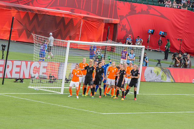 A picture of players in a goalmouth preparing for a corner in the Netherlands v New Zealand game.