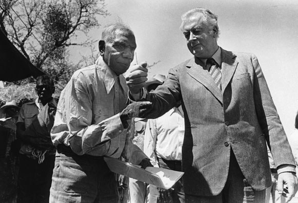 In May 1975, Gurindji people were successful in having an area of their own land excised from the Vestey pastoral lease at Wattie Creek in the Northern Territory. Prime Minister Gough Whitlam and Gurindji leader Vincent Lingiari celebrated the handover of the land at Daguragu. The event was recorded by Mervyn Bishop.