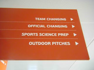 A sign from St George's Park pointing to changing rooms and offices